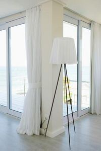 How to hang drapery over vertical blinds