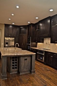 Dark cabinets w wood floors I would do lighter cabinets up top to have some brightness!