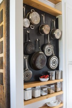 vertical storage for pans with shelves in a small kitchen