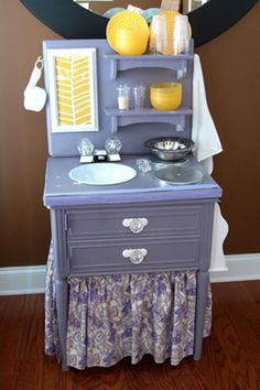 On the to-do list: make a play kitchen out of an old table/nightstand. This one is so cute!