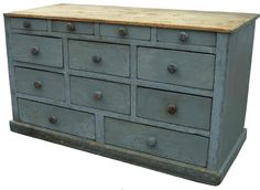Apothecary Chest blue!! Fab blue!! Love all fat wooden mushroom  knobs and multiple drawers!!! Awwwesome cross over appeal to french country!!!!