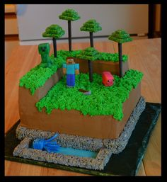 """Minecraft - Three 10"""" cakes stacked. Bricks and trees made from homemade dyed Rice Krispie treats. Dyed the melted marshmallows before adding the cereal. Also to keep the trees from sagging I coated the treats in melted candy melts before cutting. Tree trunks are made from plastic skewers I kept from an edible arrangement ad wrapped in brown floral tape. Characters are modeling chocolate"""