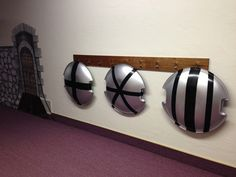 ~ Kingdom Rock V.B.S. Decorations~ Shields made from snow sleds.