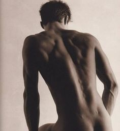 apparently Josh Duhamel but really...who cares... that is a sexy back
