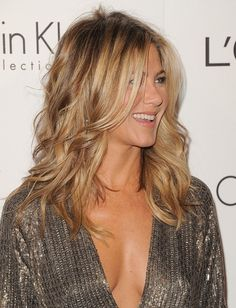 Jennifer Aniston sexy in a plunging dress and messy hair