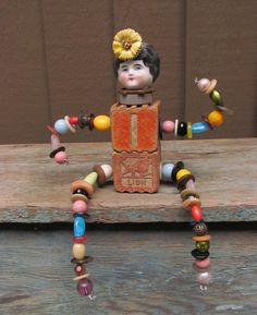Frozen Charlotte Assemblage Art Doll.  via Etsy.