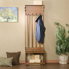 @Overstock - Upton Home Mission Oak Hall Tree Entry Bench - Bring some practical storage style into your home with this elegant, oak-entry bench. You can keep coats and shoes tidily at the front door on this dedicated piece of furniture that also gives you a handy seat to use while pulling off muddy shoes.  http://www.overstock.com/Home-Garden/Upton-Home-Mission-Oak-Hall-Tree-Entry-Bench/4851729/product.html?CID=214117 $123.96