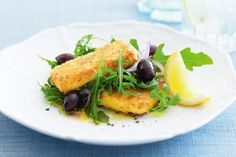 Entertaining is made easy, and delicious, with this golden starter that's cooked in five. Teamed with olives and red onions, the mild mustard flavour of baby rocket leaves makes a tasty base for crispy pan-fried haloumi.