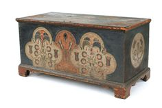 """Lehigh County, Pennsylvania painted dower chest, late 18th c., the front with two ivory clover leaf panels with stylized flowers, all on a blue/green ground supported by bracket feet, 23 1/4"""" h., 45 3/4"""" w. Provenance: Clarence Prickett."""