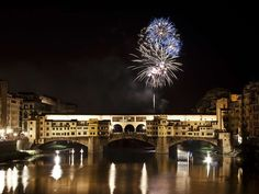 """Florence. St John is the patron saint of Florence and June 24 is a public holiday there. After a day of celebration, in the evening there are fireworks. Here you can see part of the display over the Ponte Vecchio. Mona Evans, """"Summer Solstice - St John's Day"""" http://www.bellaonline.com/articles/art180853.asp"""