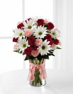 FTD Sweet Surprises Bouquet comes in 3 sizes so you can choose the right arrangement to fit your budget.