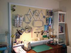 Easy to make framed pegboard (about 5' wide by 4' tall) for sewing room.  I use it to hold all of my hoops and stabilizers for my embroidery.  Coolest part is the vinyl guttering along the bottom......holds my rulers, scissors, markers, etc.  It also brightens up the whole room, because it's so big!