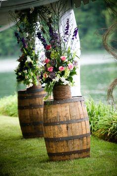 Rustic Wedding Flowers atop barrel