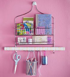 Shower caddy used as organizer. I want adhere a small mirror to the front of the basket and hang on the inside of my pantry door...hang coats, umbrella, lint brush, lipstick, spare change etc.