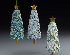 Folder paper or fabric Christmas tree ornaments on Styrofoam cones