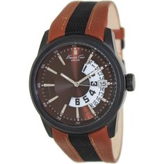 A brown dial with a day and date display characterizes this Kenneth Cole watch for men. This classic timepiece includes a black and brown leather strap and a black stainless steel case.