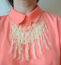 Dress up with a spooky necklace made from glow-in-the-dark skeletons. skulls, fashion, plastic, skeleton bib, bone, bib necklaces, jewelri, glowinthedark skeleton, halloween