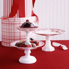 I could just make my own cake stands!    xplore your local flea market or antiques store to find the makings for these festive food servers: You'll need antique plates and short candlesticks. Stack matching plates in different sizes to make a tiered cake stand that displays your best holiday goodies.