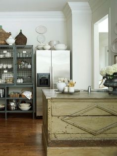 Old French retail counter as kitchen island w/ sink and dishwasher | Pamela Pierce