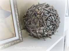 DIY twig ball made with twigs from your yard and hot glue, wrapped around a beach ball