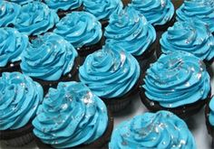 or these, black cupcakes, blue frosting, and silver somethings :)