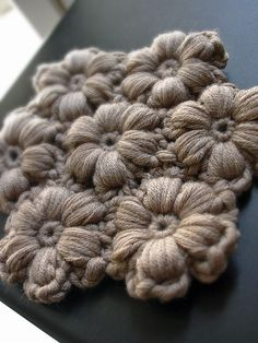 Crocheted flowers. This would made a very warm blanket using scrap yarn..