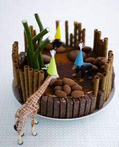 Time to party. Decorate children´s party cake with toys which have first been washed carefully.