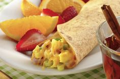 """Make that #omelet """"to go"""" by wrapping it up your fluffy #eggs, gooey #cheese, green #onion, and browned #sausage in an Azteca tortilla.  Oh, and don't forget your keys! http://www.aztecafoods.com/recipes/recipe.php?recipe=fiesta-breakfast-wraps"""