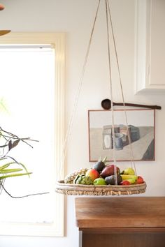 Saving counter space with a hanging fruit basket.