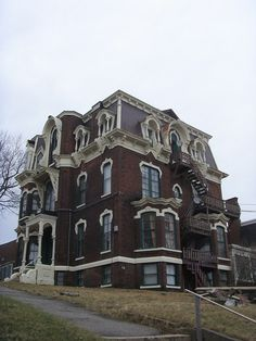 Old House, Heavily Trimmed/Adorned Second Empire on Mecklenburg Street, Saint John, New Brunswick, Canada. (Converted to apartments, notice the exterior stairs.)