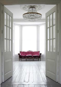 Cool white room with a shot of hot pink.