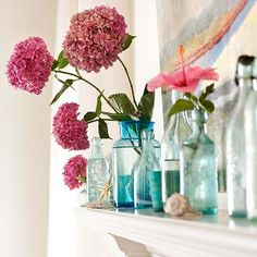 Recycled Style- so simple and pretty for a mantel. Blue bottles with pink Hydrangeas!