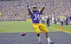 Advocate staff photo by BILL FEIG -- LSU running back Darrel Williams celebrates his touchdown run during the second quarter Saturday at Tiger Stadium. Williams had seven carries for 37 yards and two touchdowns.