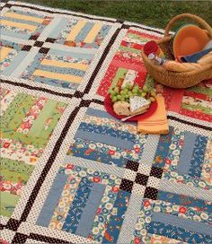 Try this Rail Fence Picnic Quilt. This picnic blanket pattern combines rail fence blocks with nine patches and a bold black and white sashing for a quilt with a retro feel.