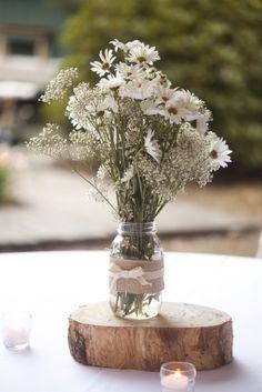 16. Table Setting Theme #modcloth #wedding flowers in mason jars on wooden block