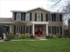 Painted Brick Homes Before And After | Taupe brick, Red door, Black shutters and garage