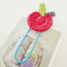 The pattern provided doesn't exactly match the picture. There's an extra row crocheted in the apple in the picture. So i tweaked it a little. But still turned out super cute!!  Crochet Apple paper clip bookmark