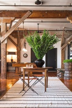 See @behrpaint in action in this inspiring LA arts district loft tour. Click through to see the full space and more info on paint colors. Door casings are Behr Olive Leaf, doors and windows are Behr Broadway, entry walls are Behr Thorny Branch.