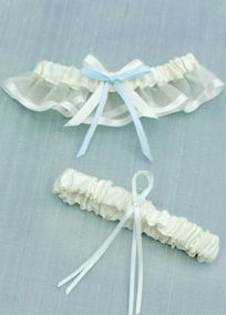 What a charming garter set! The keepsake garter features a satin band with organza ruffle, satin trim, and is topped off with a cheerful double satin bow in blue and ivory.  Coordinating toss garter is also made of satin, and is embellished with a blue and ivory satin ribbon.A nice garter set for the cheerful bride!Available in Ivory only.
