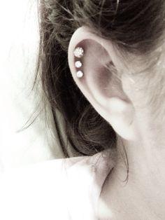 three cartilage piercings