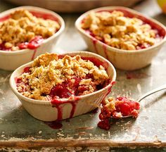 Apple, rhubarb and strawberry crumbles: A rustic pud is made new with strawberries and shredded coconut. It's lucky that everyone gets their own, because there will be no sharing here