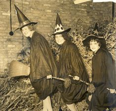 Three festive Halloween witches appear ready to take off into flight in this charming 1920s photograph. #vintage #Halloween #witch #costume #1920s #twenties