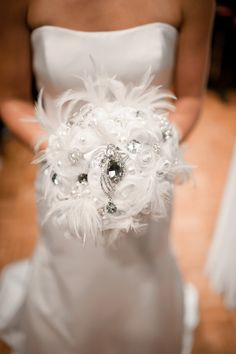 white feather bouquet brooch bouquets, gold weddings, wedding planning, wedding bouquets, wedding planners, floral designs, winter weddings, feather, broach bouquets