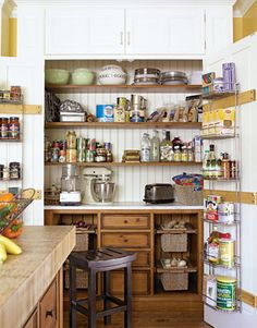 What a great idea for combining storage and awork station. Small appliances don't have to be dragged out, onions and potatoes have their own bins YET all can be hidden by the simple closing of these double doors.