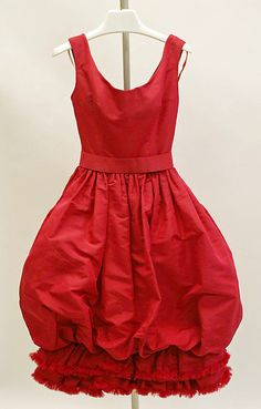 "Red silk bubble-hem cocktail dress, by Yves Saint Laurent for House of Dior, French, fall/winter 1959–60. Label: ""Automne-Hiver 1959/Christian Dior, Paris"""