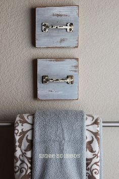 Attach cute handles to painted plaques for hand towel holders.