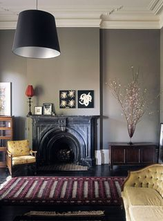 black fireplace, grey walls