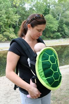 Turtle Shell Baby Carrier Accessory Ergo Cover with Huge Storage Pocket. $65.00, via Etsy.