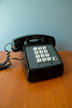1980's Black Push Button Phone.  My grandparents had one and I loved playing on it.