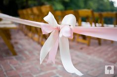 Loved the ribbons that were untied before the bride walked down the outdoor aisle.